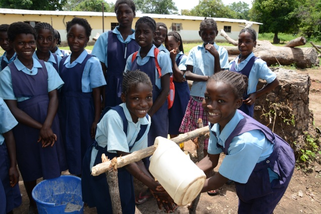 Through SPLASH, WASH-Friendly Schools in Zambia teach students about the importance of hand washing and provide hand washing stations nearby latrines.